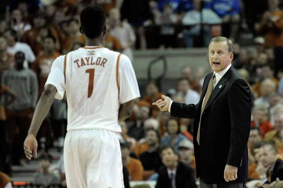 AUSTIN, TX - FEBRUARY 01:  Head coach Rick Barnes of the Texas Longhorns speaks with Isaiah Taylor #1 during a game against the Kansas Jayhawks at The Frank Erwin Center on February 1, 2014 in Austin, Texas.  Texas won the game 81-69. Photo: Stacy Revere, Getty Images / 2014 Getty Images