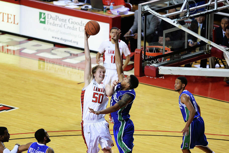 Lamar Cardinals Sebastian Norman, No. 50, drives the ball in during Saturday's game against A&M-Corpus Christi Islanders at the Montagne Center. Michael Rivera/@michaelrivera88