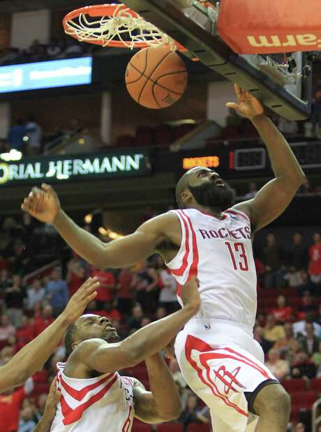 Rockets guard James Harden (13) scored 28 points Saturday night in his first game since suffering an injury to his left thumb. Photo: Mayra Beltran, Staff / © 2013 Houston Chronicle