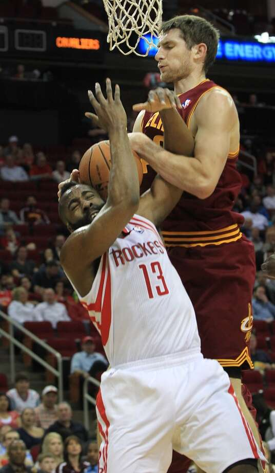 Rockets shooting guard James Harden (13) is blocked by Cavaliers center Tyler Zeller. Photo: Mayra Beltran, Houston Chronicle