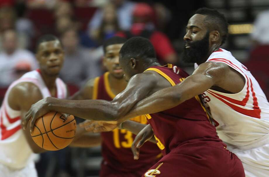 Cavaliers small forward Luol Deng (9) drives the ball toward the basket as Rockets shooting guard James Harden (13) attempts to steal the ball. Photo: Mayra Beltran, Houston Chronicle