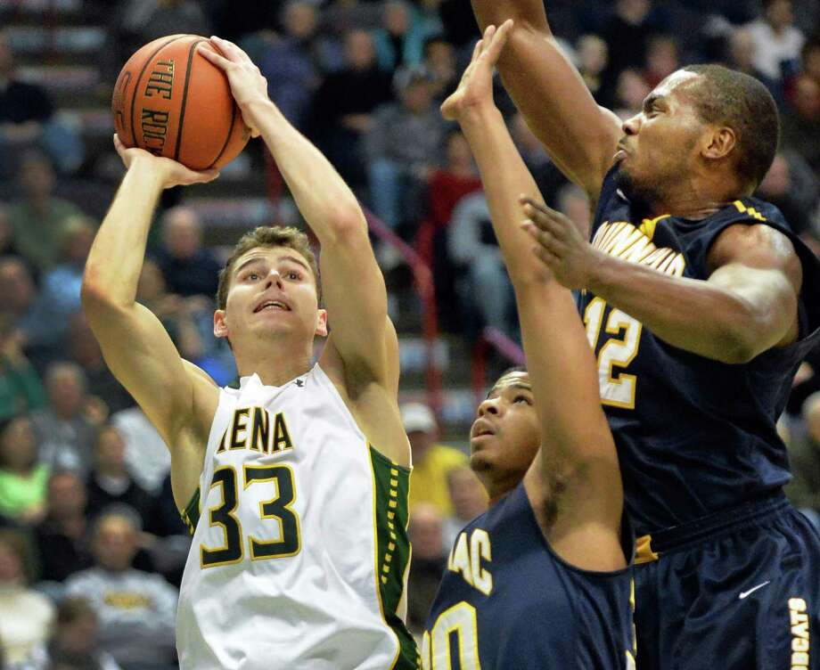 Siena's # 33 Rob Poole, left, shoots around Quinnipiac defenders #30 James Ford, Jr. and #12 Marquis Barnett, at right, during Saturday's game at the Times Union Center Feb. 1, 2014, in Albany, NY.  (John Carl D'Annibale / Times Union) Photo: John Carl D'Annibale / 00025516A