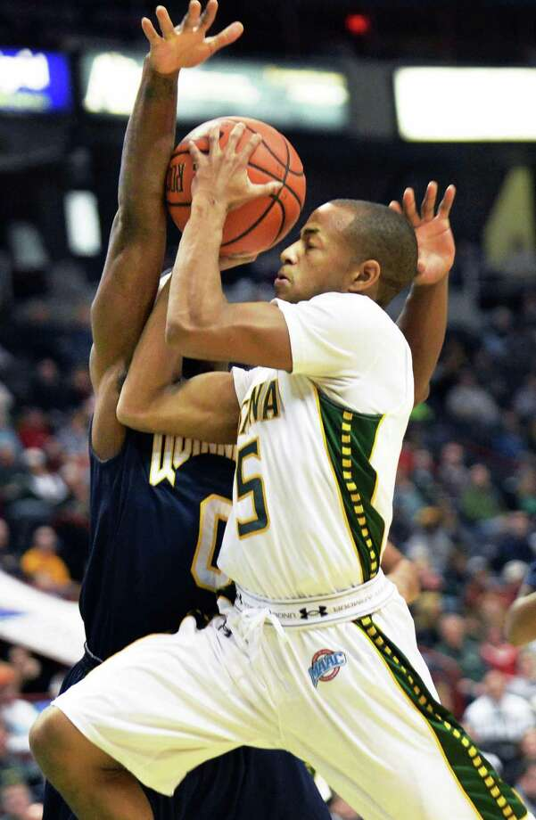 Siena's # 5 Evan Hymes and Quinnipiac's #0 Umar Shannon, at left, during Saturday's game at the Times Union Center Feb. 1, 2014, in Albany, NY.  (John Carl D'Annibale / Times Union) Photo: John Carl D'Annibale / 00025516A
