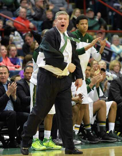 Siena head coach Jimmy Patsos cheers his players on during Saturday's game against Quinnipiac at the