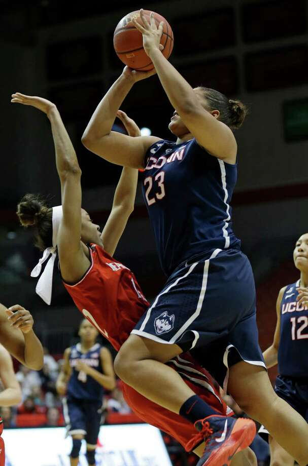 Connecticut forward Kaleena Mosqueda-Lewis (23) charges into Cincinnati guard Alyesha Lovett during the first half of an NCAA college basketball game, Saturday, Feb. 1, 2014, in Cincinnati. (AP Photo/Al Behrman) Photo: Al Behrman, Associated Press / Associated Press