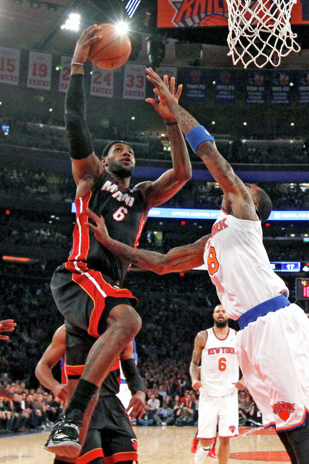 Miami Heat's LeBron James (6) goes to the basket against New York Knicks' J.R. Smith (8)  during the first half of an NBA basketball game Saturday, Feb. 1, 2014, in New York. (AP Photo/Jason DeCrow) ORG XMIT: MSG104 Photo: Jason DeCrow / FR103966 AP