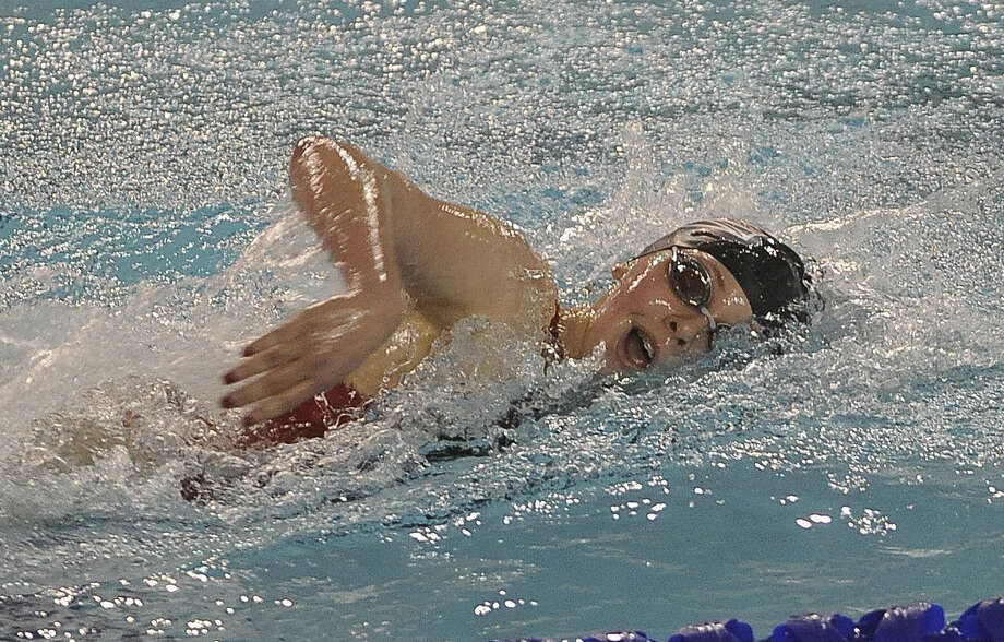 Haley Herzberg of Churchill competes in the girls 500-yard freestyle, one of two individual events she won at the District 26-5A meet at Davis Natatorium. Photo: Photos By Billy Calzada / San Antonio Express-News / San Antonio Express-News