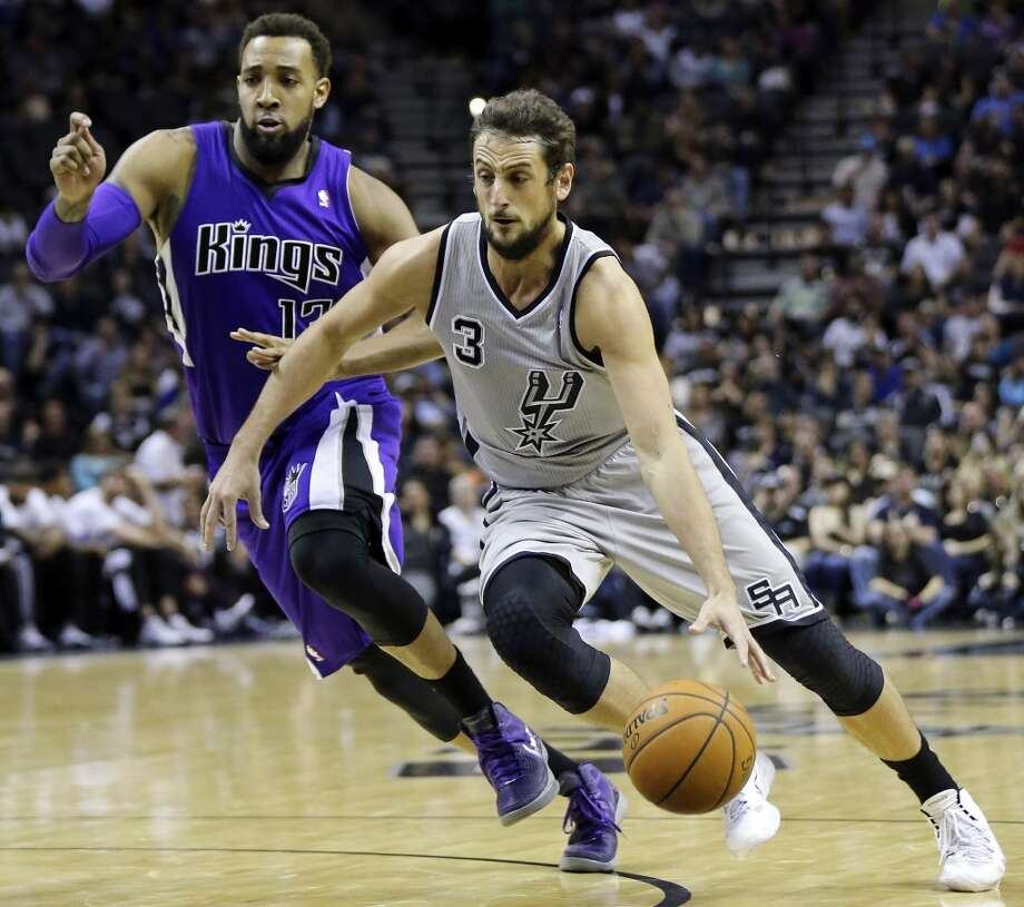 San Antonio Spurs' Marco Belinelli looks for room around Sacramento Kings' Derrick Williams during first half action Saturday Feb. 1, 2014 at the AT&T Center. Photo: San Antonio Express-News