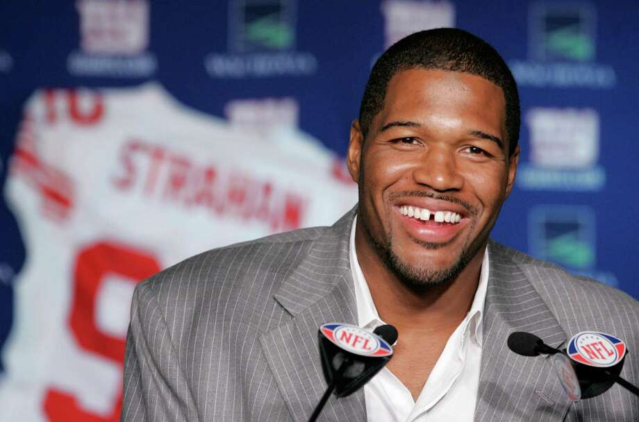 New York Giants Michael Strahan talks about his retirement from football during a news conference at Giants Stadium in East Rutherford, N.J., Tuesday, June 10, 2008. Strahan says his decision to retire after 15 seasons arose from a desire to leave on his own terms _ and finishing with a Super Bowl title didn't hurt.  (AP Photo/Mike Derer) Photo: Mike Derer, STF / AP