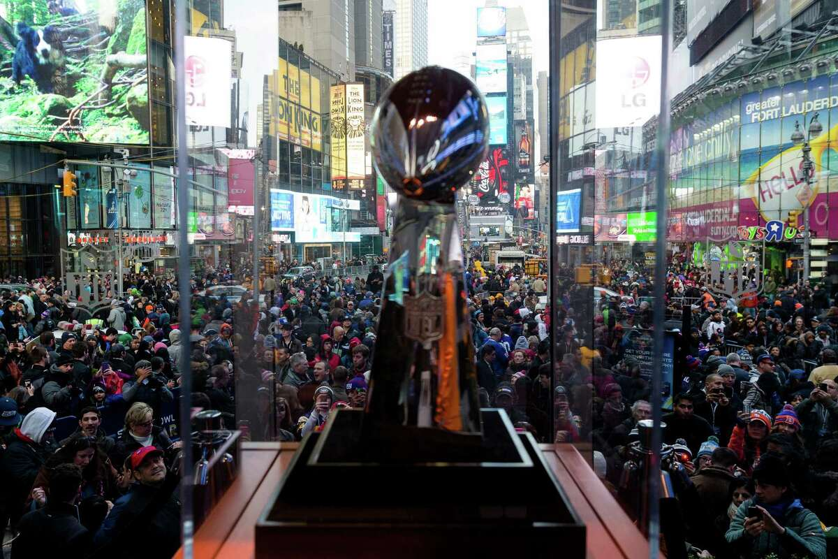 A view of tens of thousands crammed into Times Square the day before Super Bowl XLVIII to catch a glimpse of the Vince Lombardi trophy Saturday, Feb. 1, 2014, in New York City.