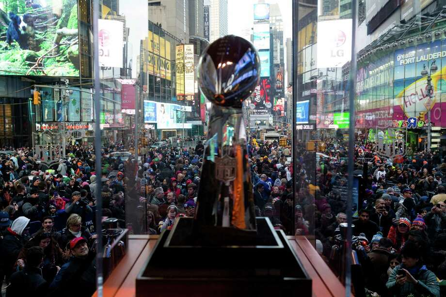 A view of tens of thousands crammed into Times Square the day before Super Bowl XLVIII to catch a glimpse of the Vince Lombardi trophy Saturday, Feb. 1, 2014, in New York City. Photo: JORDAN STEAD, SEATTLEPI.COM / SEATTLEPI.COM