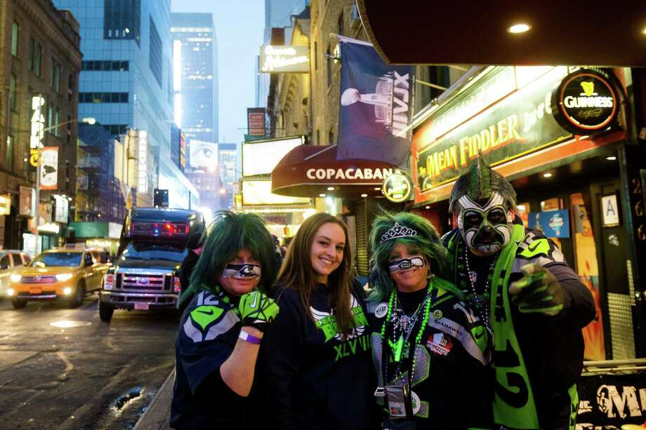 "The ""Paintedhawk"", right, and friends leave the Copacabana bar to celebrate the day before Super Bowl XLVIII Saturday, Feb. 1, 2014, in New York City. Photo: JORDAN STEAD, SEATTLEPI.COM / SEATTLEPI.COM"