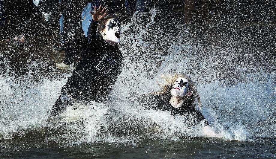 A very moist KISS:Team KISS members Mayson Morissette (left) and Jenny McKenzie jump into frigid Wolf River harbor during   the annual Polar Bear Plunge in Memphis, Tenn. Photo: Mark Weber, Associated Press