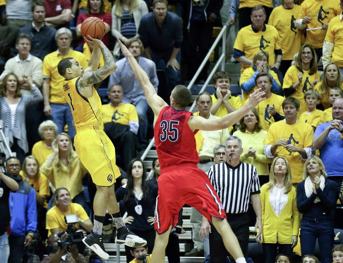 Justin Cobbs, a 6-foot-3 guard, shoots the game-winner over 7-foot center Kaleb Tarczewski to defeat top-ranked Arizona.