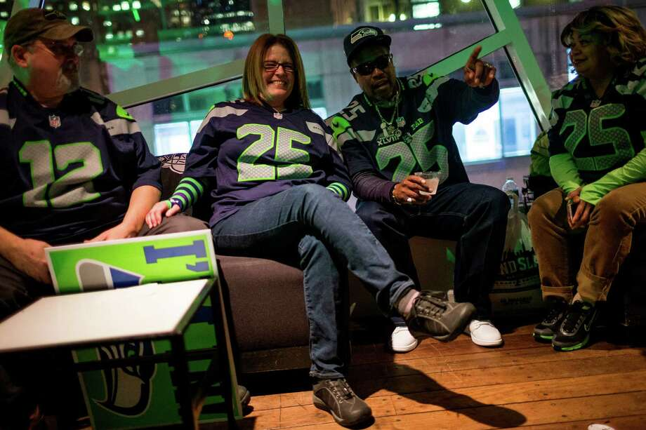 Kevin Sherman, center right, father of Richard Sherman, parties with Seahawks fans in the bar Copacabana to celebrate the day before Super Bowl XLVIII Saturday, Feb. 1, 2014, in New York City. Photo: JORDAN STEAD, SEATTLEPI.COM / SEATTLEPI.COM