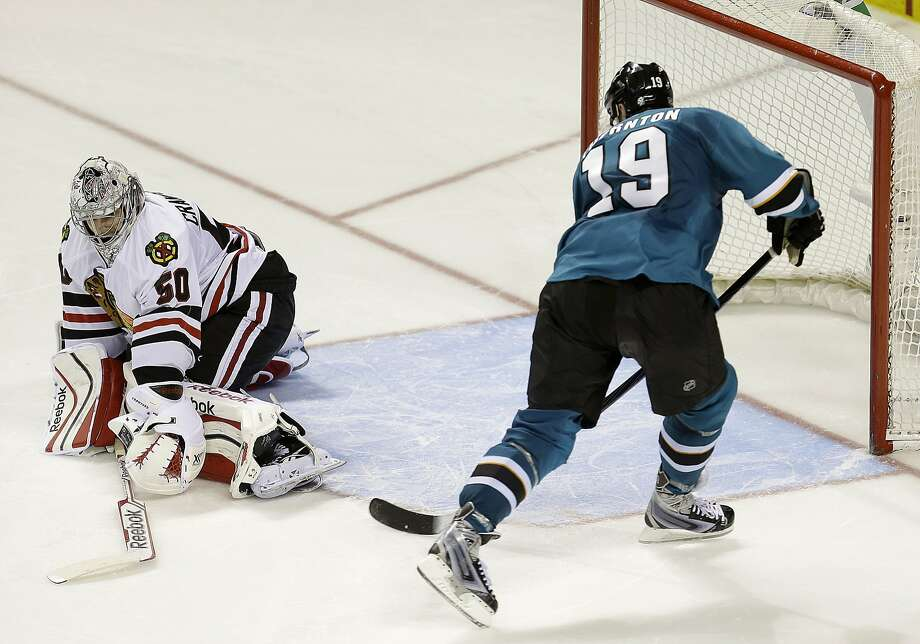 After Patrick Marleau went 5-hole, the Sharks' Joe Thornton faked out Chicago goalie Corey Crawford and shot into a wide-open net for the game-winner. Photo: Tony Avelar, Associated Press