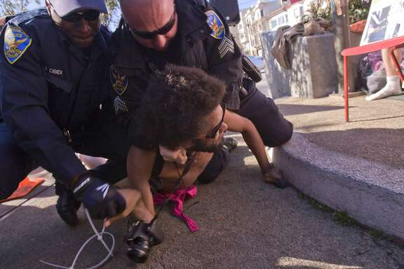 A protestor that goes by Rusty being arrested during a nudity ban demonstration in Castro District in San Francisco, Calif. on Saturday, Feb. 1, 2014. A city ordinance authored by supervisor Scott Weiner that bans public nudity was implemented on Feb. 1 , 2013. Children under 5 and attendees of certain permitted events such as the Folsom Street Fair and Bay to Breakers Footrace are exempt from the ban. Both Gypsy and Jimmy were arrested later in the same afternoon for violating the Supervisor Weiner's ordinance
