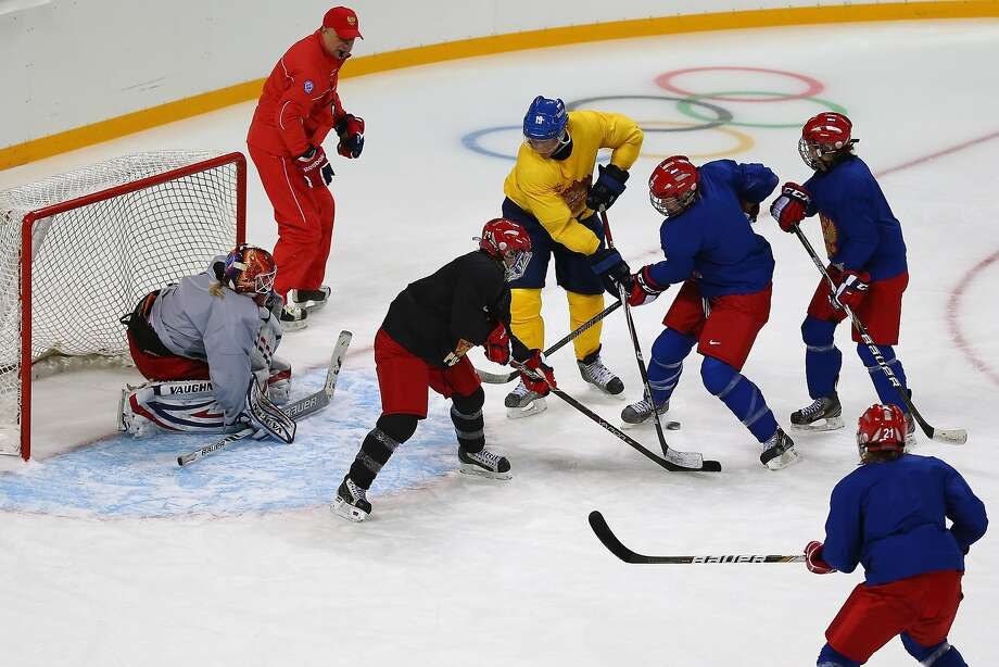 Russian Olympic team players scrimmage in preparation for Sochi, where they will try to end U.S.-Canadian domination. Photo: Martin Rose, Getty Images