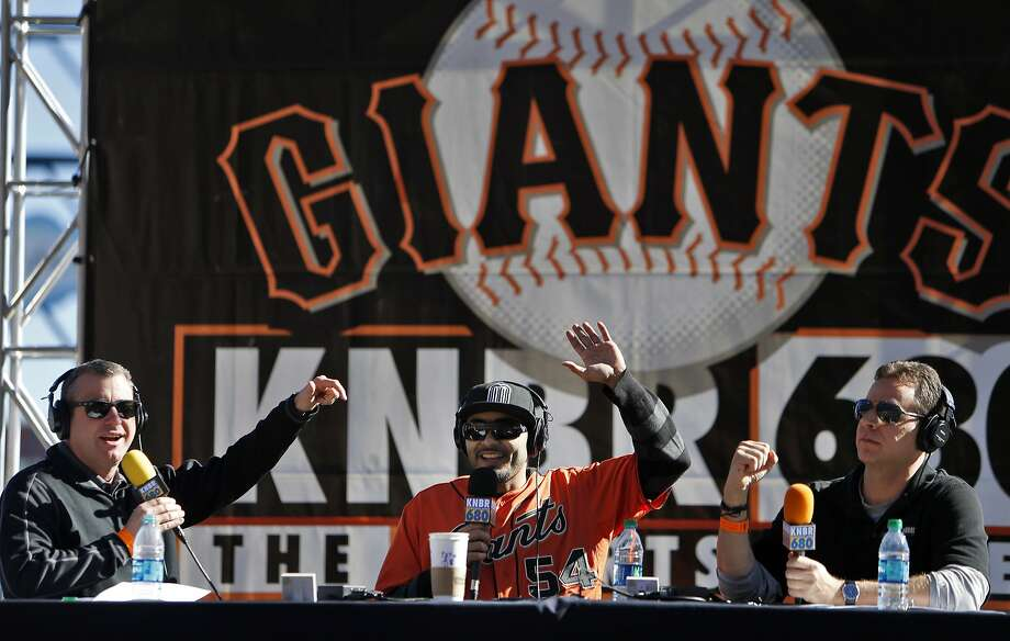 Closer Sergio Romo waves to fans as he finishes an interview session with KNBR's Brian Murphy (left) and Paul McCaffrey at Giants FanFest at AT&T Park. Photo: Carlos Avila Gonzalez, The Chronicle