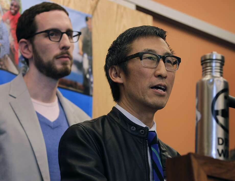 Supervisors Eric Mar (right) and Scott Wiener speak at a rally to launch a campaign to tax soft drinks and sugar-sweetened beverages in San Francisco, Calif. on Saturday, Feb. 1, 2014. Mar and Wiener combined two competing measures to create a unified effort that would charge a 2-cents-per-ounce sugary drink tax. Photo: Paul Chinn, The Chronicle