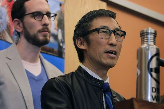 Supervisors Eric Mar (right) and Scott Wiener speak at a rally to launch a campaign to tax soft drinks and sugar-sweetened beverages in San Francisco, Calif. on Saturday, Feb. 1, 2014. Mar and Wiener combined two competing measures to create a unified effort that would charge a 2-cents-per-ounce sugary drink tax.