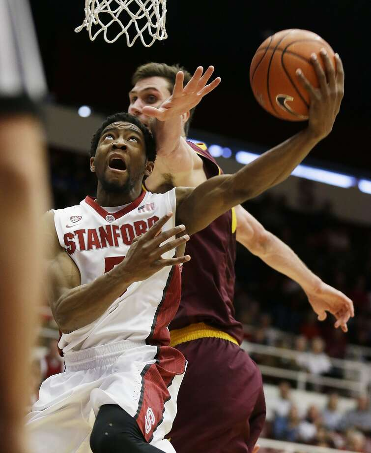 Stanford's Chasson Randle, who scored 21 points, drives past Jordan Bachynski for a layup attempt in the second half. Photo: Eric Risberg, Associated Press