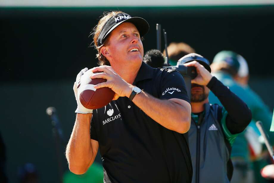 Tossing a football to the record crowd in Scottsdale seemed to throw off Phil Mickelson's game. Photo: Sam Greenwood, Getty Images