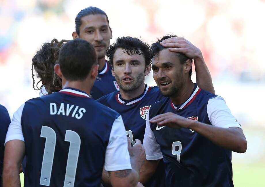 Chris Wondolowski (right) celebrates his second goal against South Korea with U.S. teammates Brad Davis (from left), Omar Gonzalez and Michael Parkhurst. Photo: Victor Decolongon, Getty Images