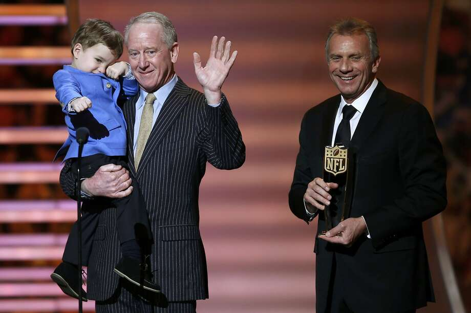 Peyton Manning's father, Archie, and son, Marshall, receive the NFL MVP award from 49ers Hall of Famer Joe Montana. Photo: Carlo Allegri, Reuters