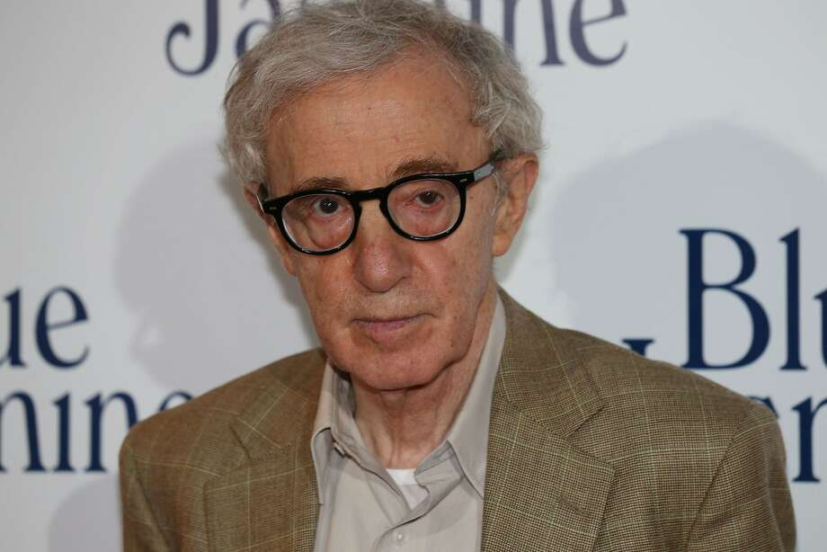 """In this file photo dated August 27, 2013 shows US film director Woody Allen posing during a photocall for the French Premiere screening of """"Blue Jasmine"""", his latest movie Paris.  The adopted daughter of Woody Allen has spoken for the first time about the alleged sexual abuse she suffered at the hands of the legendary Hollywood director during her childhood.  In an open letter published on a New York Times blog, February 1, 2014, Dylan Farrow, adopted by Allen during his relationship with actress Mia Farrow, detailed being abused by the director when she was seven years old. Photo: Thomas Samson, AFP/Getty Images"""