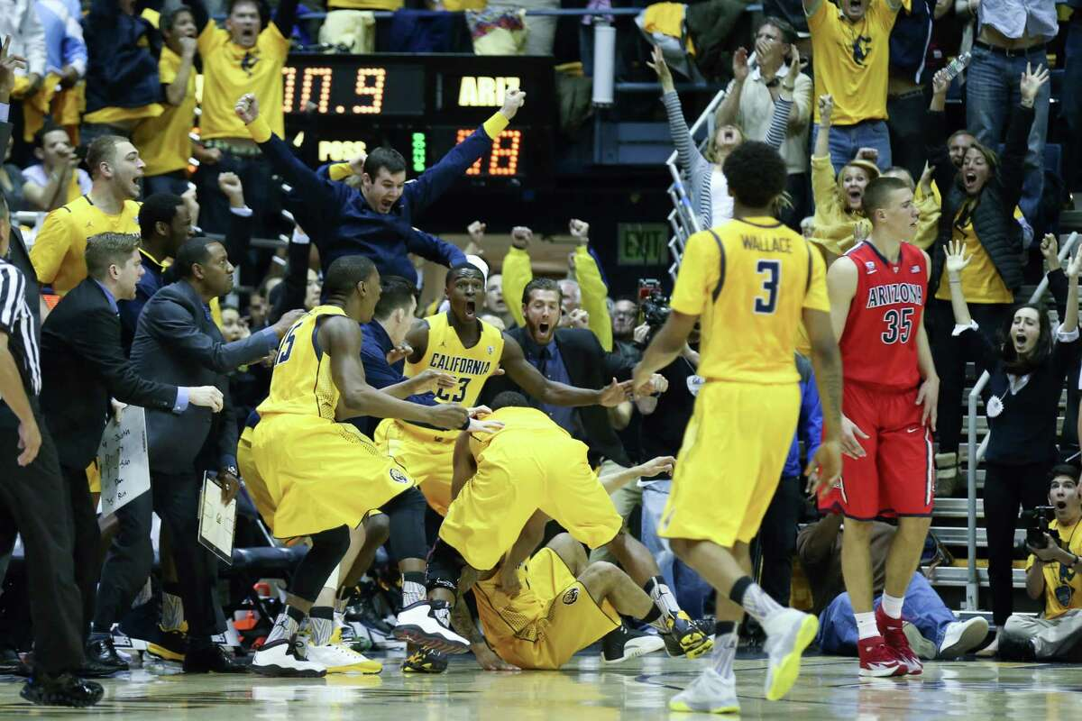 Cobbs celebrates, as do all those around him, after his big shot and before Arizona's final possession proved fruitless.