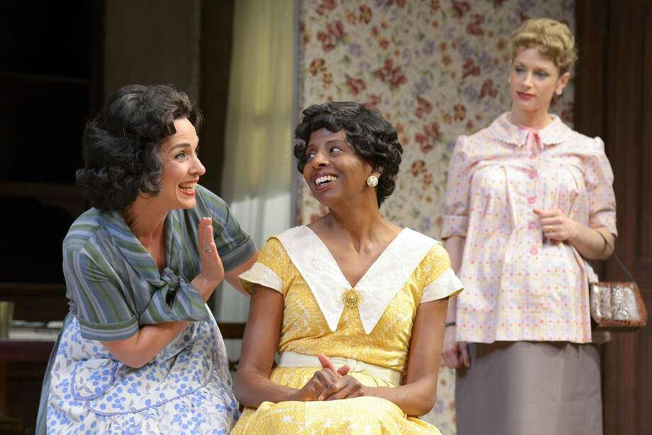 "Bev (Lynda DiVito, left) pulls her housekeeper Francine (Velina Brown) into the argument about a whether a black family should move into the neighborhood as deaf , pregnant Betsy (Kendra Lee Oberhauser) looks on in the 1959 segment of ""Clybourne Park"" at Center Rep. Photo: Alessandra Mello"