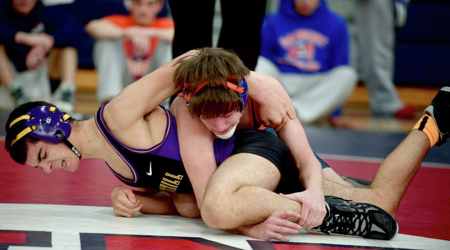 Westhill's Matt Conte, bottom, and Danbury's Joey Hulse during New Fairfield High School's Duals Tournament, on Saturday, February 1, 2014, in New Fairfield, Conn. They are wrestling in the 120 lb. class. Photo: H John Voorhees III / The News-Times Freelance
