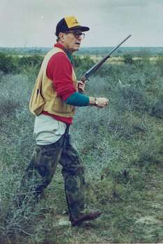 US Pres. George Bush aptly dressed in hunting gear w. rifle in hand hunting quail on the Lazy F ranch in 1989. Photo: David Valdez, Time & Life Pictures/Getty Image