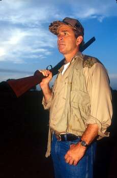 Texas Governor George W. Bush looks for an opportunity on the first day of Dove hunting season in Hockley, Texas, September 1, 1994. Photo: Paul S. Howell, Getty Images