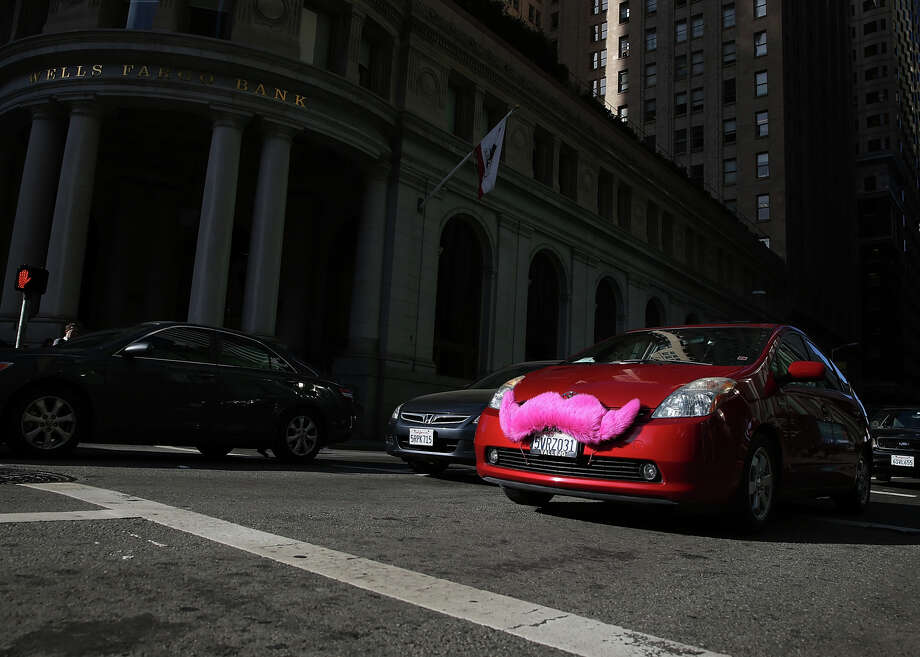 Drivers for services including Lyft, identified by its pink mustache, would be able to purchase an amendment to their policies that would cover the time they are waiting to be summoned by a rider, as required by a new state law. Photo: Justin Sullivan / Getty Images / 2014 Getty Images
