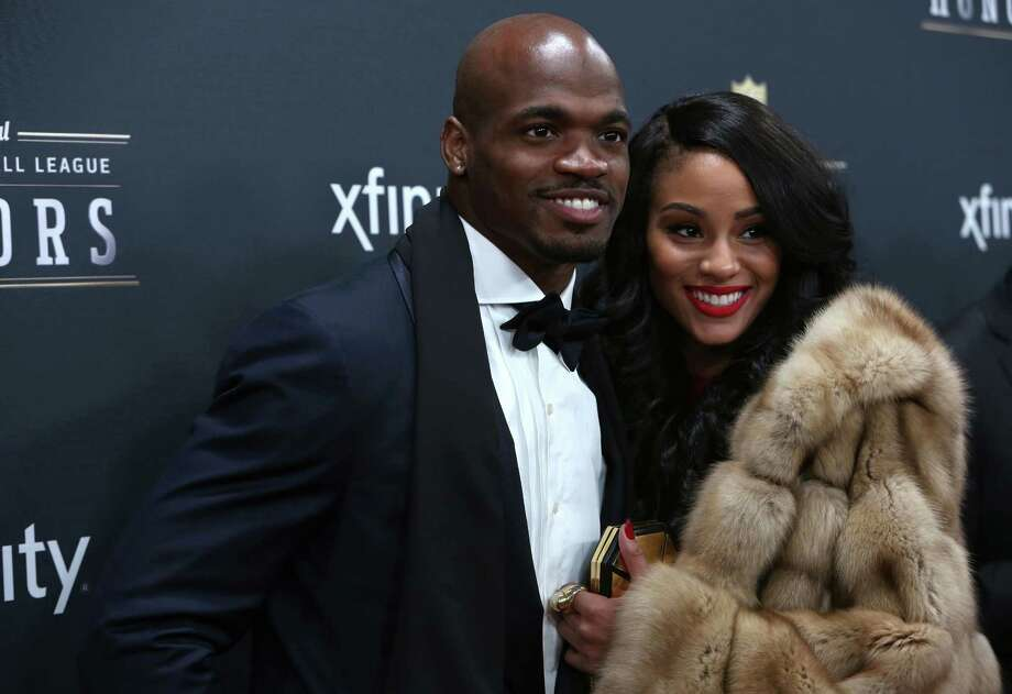 Minnesota Vikings player Adrian Peterson and his wife Ashley walk the red carpet before the NFL Honors awards ceremony on Saturday, February 1, 2014 at Radio City Music Hall in New York City. Photo: JOSHUA TRUJILLO, SEATTLEPI.COM / SEATTLEPI.COM