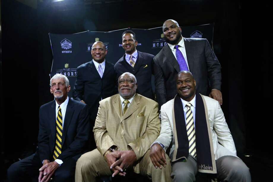 New NFL Hall of Fame electees, clockwise from top left, former cornerback and free safety Aeneas Williams, wide receiver Andre Reed, offensive tackle Walter Jones, linebacker Derrick Brooks , defensive lineman Claud Humphrey, and punter Ray Guy pose for a photo at the NFL Honors ceremony on Saturday, February 1, 2014 at Radio City Music Hall in New York City.. Photo: JOSHUA TRUJILLO, SEATTLEPI.COM / SEATTLEPI.COM