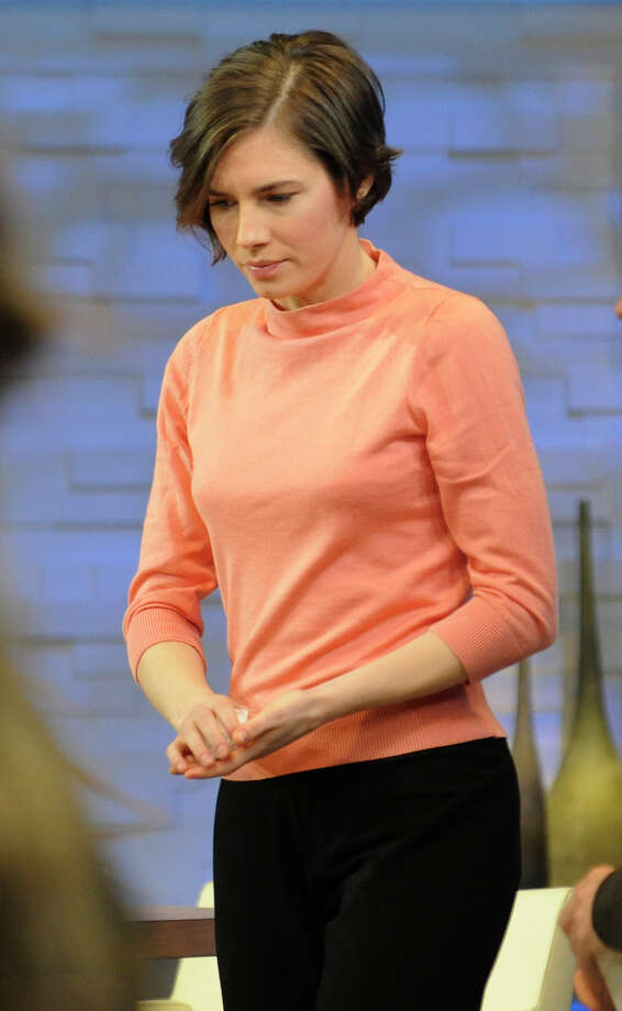 "Amanda Knox is seen on the set of ABC's ""Good Morning America"", Friday, Jan. 31, 2014, in New York. Knox said Friday in an interview with Robin Roberts that she will fight the reinstated guilty verdict against her and an ex-boyfriend in the 2007 slaying of a British roommate in Italy and vowed to ""never go willingly"" to face her fate in that country's judicial system. Photo: Louis Lanzano, AP  / FR77522 AP"