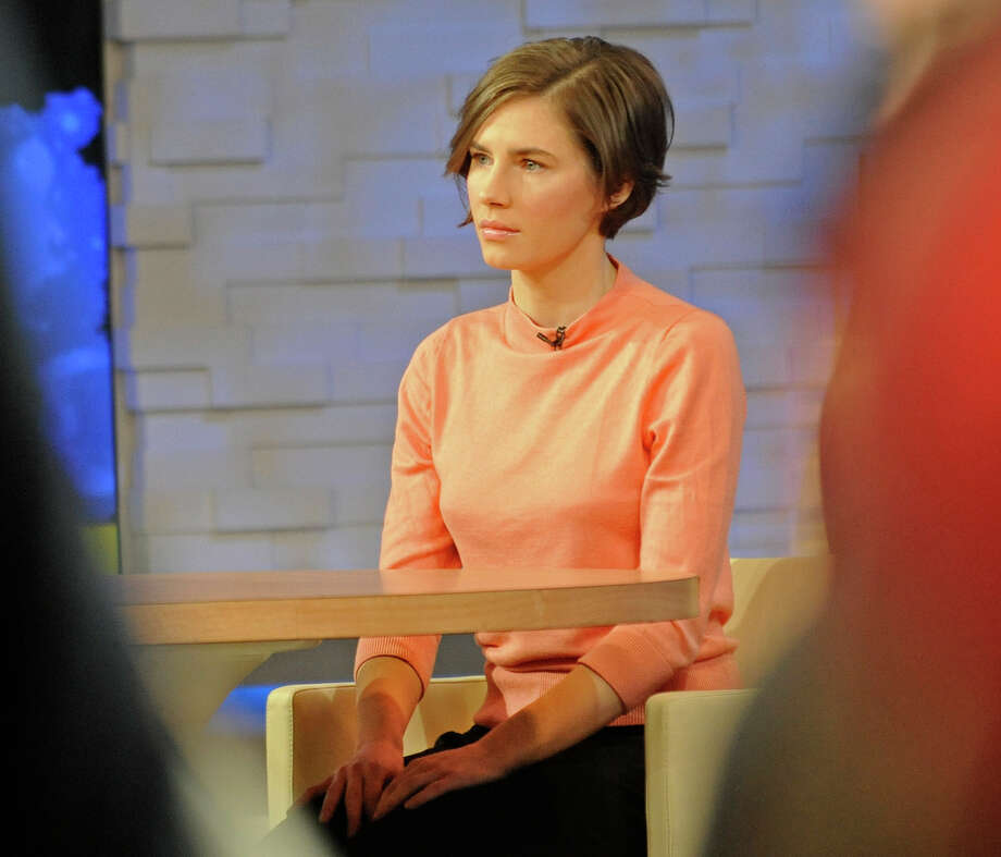 "Amanda Knox waits on a television set for an interview, Friday, Jan. 31, 2014 in New York. Knox said she will fight the reinstated guilty verdict against her and an ex-boyfriend in the 2007 slaying of a British roommate in Italy and vowed to ""never go willingly"" to face her fate in that country's judicial system . ""I'm going to fight this to the very end,"" she said in an interview with Robin Roberts on ABC's ""Good Morning America."" Photo: Louis Lanzano, AP  / FR77522 AP"