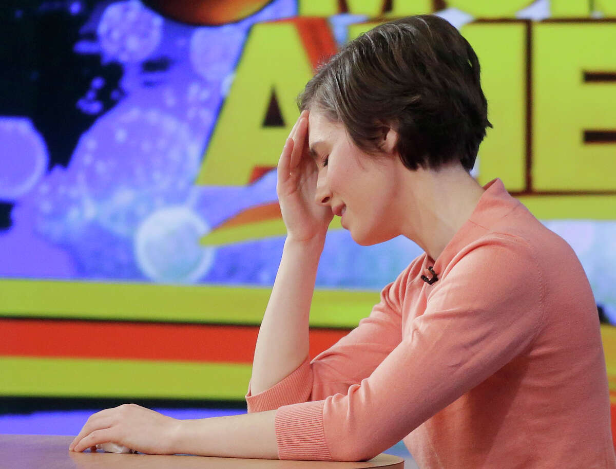Amanda Knox puts her hand to her forehead while making a television appearance, Friday, Jan. 31, 2014 in New York. Knox said she will fight the reinstated guilty verdict against her and an ex-boyfriend in the 2007 slaying of a British roommate in Italy and vowed to