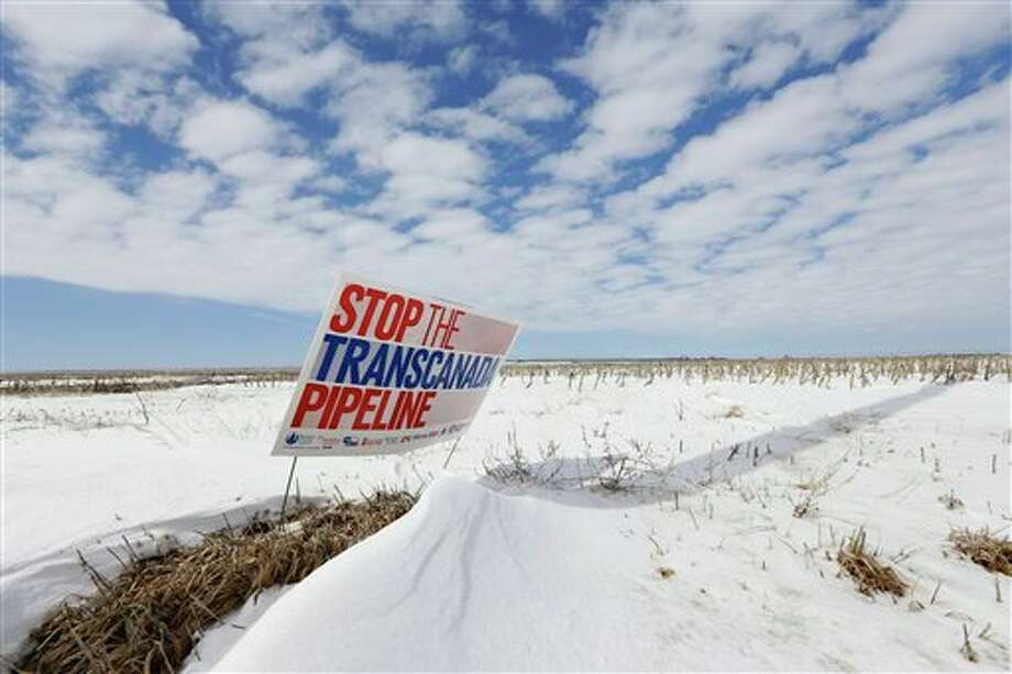 """A sign reading """"Stop the Transcanada Pipeline"""" stands in a field near Bradshaw, Neb. The proposed Keystone XL pipeline will run through this field.  In a move that disappointed environmental groups and cheered the oil industry, the Obama administration on Jan. 31, 2014, said it had no major environmental objections to the proposed Keystone XL oil pipeline from Canada. Photo: NH, AP"""