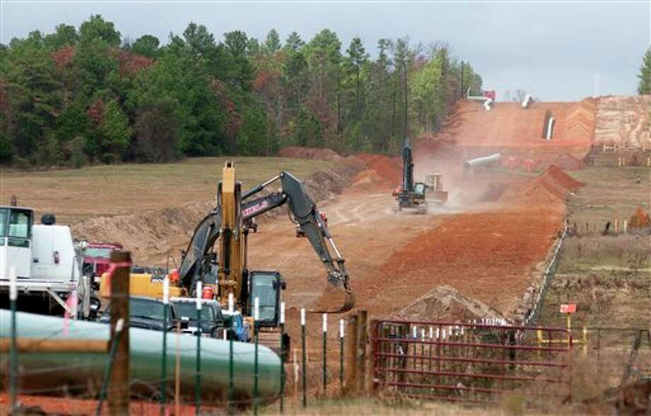 Crews work on construction of the TransCanada Keystone XL Pipeline near County Road 363 and County Road 357, east of Winona, Texas.  In a move that disappointed environmental groups and cheered the oil industry, the Obama administration on Jan. 31, 2014, said it had no major environmental objections to the proposed Keystone XL oil pipeline from Canada. Photo: Sarah A. Miller, AP