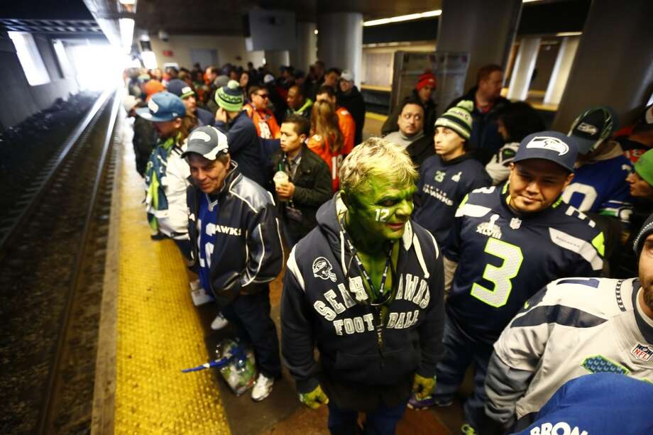 Football fans wait to get on a train at the Secaucus Junction, Sunday, Feb. 2, 2014, in Secaucus, N.J. The Seattle Seahawks are scheduled to play the Denver Broncos in the NFL Super Bowl XLVIII football game on Sunday, evening at MetLife Stadium in East Rutherford, N.J. (AP Photo/Matt Rourke) Photo: Matt Rourke, ASSOCIATED PRESS