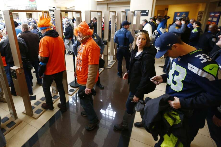 Football fans go through security at the Secaucus Junction, Sunday, Feb. 2, 2014, in Secaucus, N.J. The Seattle Seahawks are scheduled to play the Denver Broncos in the NFL Super Bowl XLVIII football game on Sunday evening at MetLife Stadium in East Rutherford, N.J. (AP Photo/Matt Rourke) Photo: Matt Rourke, ASSOCIATED PRESS