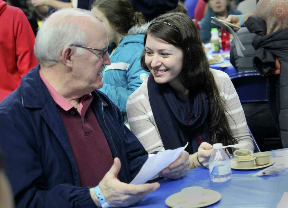 Kristin Oakes, of Weston, talks soup with her father, Will, at the 6th annual Chowdafest  at the Webster Bank Arena in Bridgeport, Conn. on Sunday, Feb. 2, 2014. Chowdafest benefits the Connecticut food bank. Photo: BK Angeletti, B.K. Angeletti / Connecticut Post freelance B.K. Angeletti
