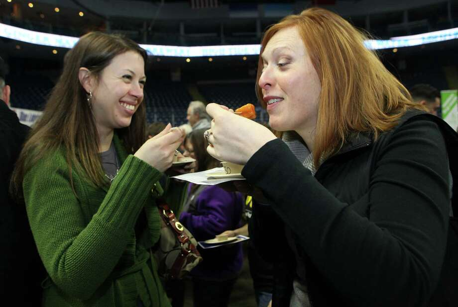 Jessica Finn, left, of Norwalk, and Allison Enright, of Milford, taste soup at the 6th annual Chowdafest  at the Webster Bank Arena in Bridgeport, Conn. on Sunday, Feb. 2, 2014. Chowdafest benefits the Connecticut food bank. Photo: BK Angeletti, B.K. Angeletti / Connecticut Post freelance B.K. Angeletti