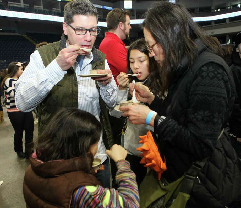 The Fengels family, Brian, Zinia, 8, Olive, 12, and Jeeran, of Norwalk, taste soup at the 6th annual Chowdafest  at the Webster Bank Arena in Bridgeport, Conn. on Sunday, Feb. 2, 2014. Chowdafest benefits the Connecticut food bank. Photo: BK Angeletti, B.K. Angeletti / Connecticut Post freelance B.K. Angeletti