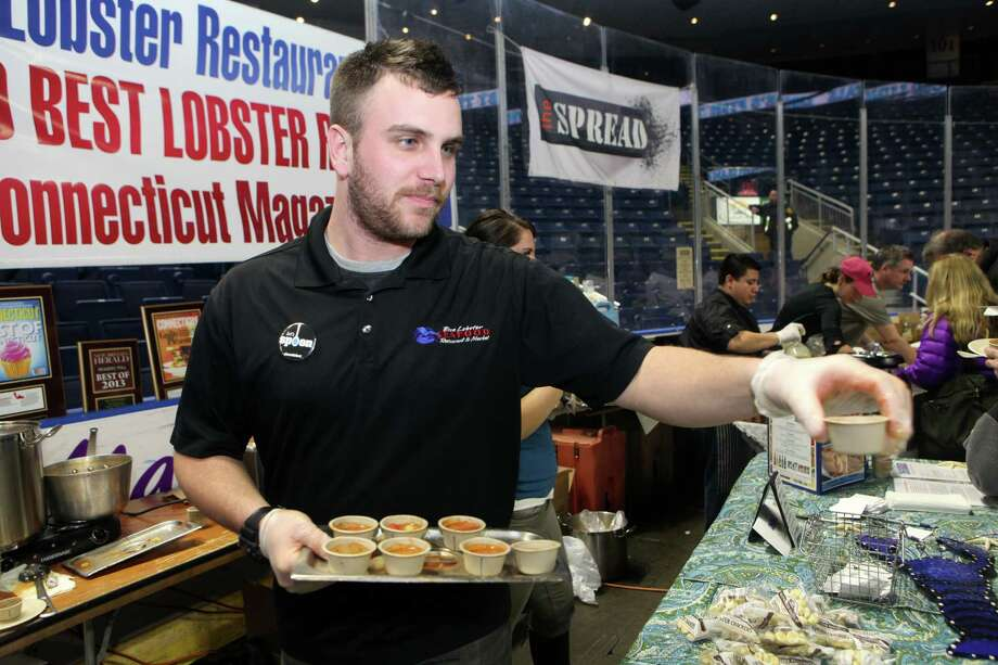 Malachy Fitzgerald serve soup from the Blue Lobster in Berlin, Conn. at the 6th annual Chowdafest  at the Webster Bank Arena in Bridgeport, Conn. on Sunday, Feb. 2, 2014. Chowdafest benefits the Connecticut food bank. Photo: BK Angeletti, B.K. Angeletti / Connecticut Post freelance B.K. Angeletti