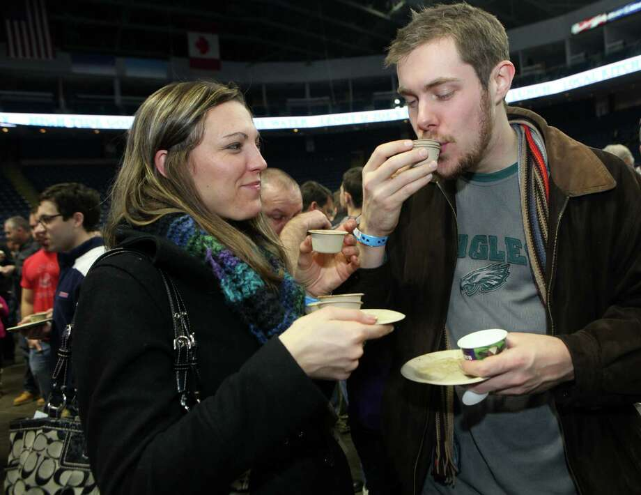 Kristin and Eric Woods, of Norwalk, taste soup at the 6th annual Chowdafest  at the Webster Bank Arena in Bridgeport, Conn. on Sunday, Feb. 2, 2014. Chowdafest benefits the Connecticut food bank. Photo: BK Angeletti, B.K. Angeletti / Connecticut Post freelance B.K. Angeletti
